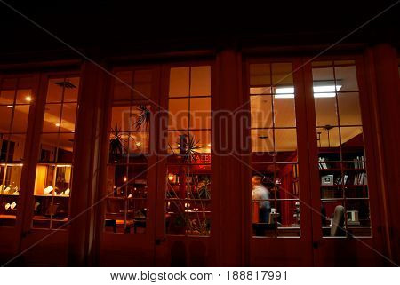 OLD SACRAMENTO, CALIFORNIA, USA - November 14, 2009: Clerk walks around a high end Jewelry store at night after closing hours