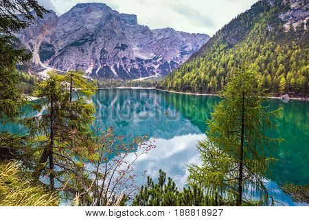 Stroll around the beautiful alpine lake Lago di Braies. The concept of walking and eco-tourism. Travel to South Tyrol, Italy