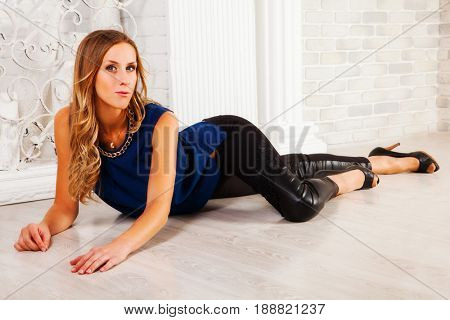 Beautiful blonde in dark clothes