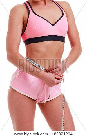 Fitness woman with measure tape isolated on white background