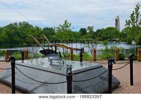 NAPERVILLE, ILLINOIS - MAY 26, 2017: Farm Families Monument in Farmers Plaza at the Naperville Riverwalk. The Riverwalk follows the West Branch of the DuPage River.