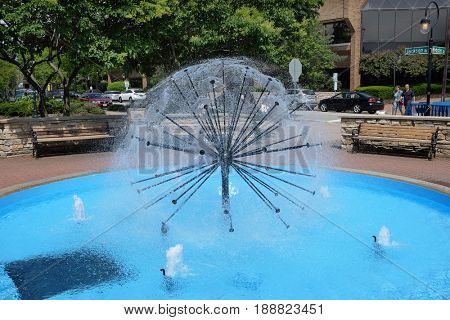 NAPERVILLE, ILLINOIS - MAY 26, 2017: Dandelion Fountain in the Naperville Riverwalk. The Riverwalk follows the West Branch of the DuPage River.