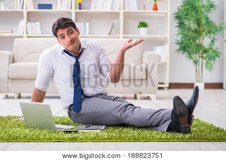 Businessman sitting on the floor in office