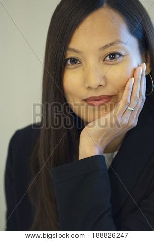 Asian businesswoman with head in hands