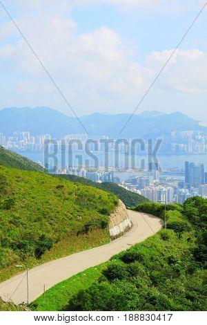 Asphalt winding curve road to city