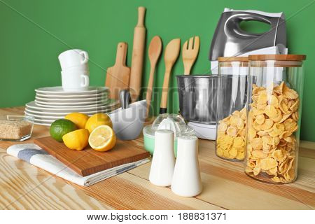 Kitchen utensils and cookware for cooking classes on wooden table