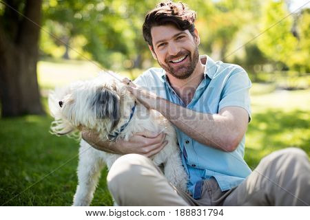 Portrait of man with dog in park on sunny a day