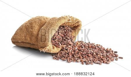 Textile sack with cocoa nibs on white background