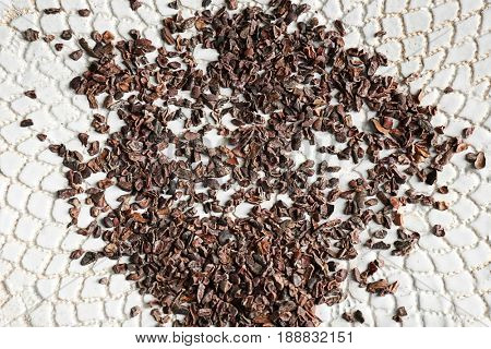 Cocoa nibs on plate, closeup