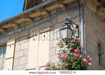 Detail French house with roses and lantern