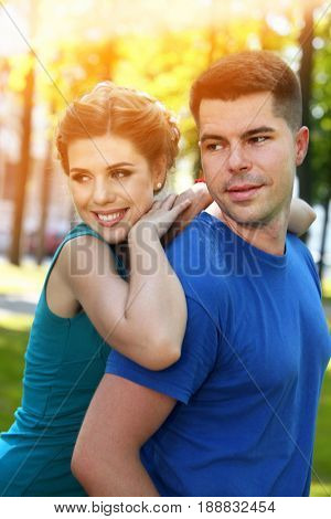 Spring couple walking park . Summer friends walk outdoor. First date in good weather day. Newlyweds make photo for memory. Lights of sun on background. Good mood and happy and artistic sunlight.
