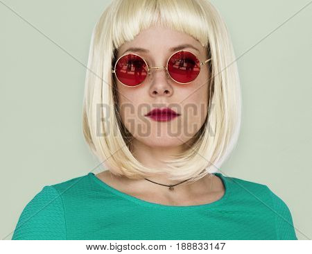 A Girl with a Blonde Wig and Sunglasses Staring