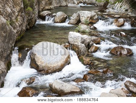 Mountain river, beautiful mountain shoal water. Water rapids. Mountain river, forest green rapid waterfall.