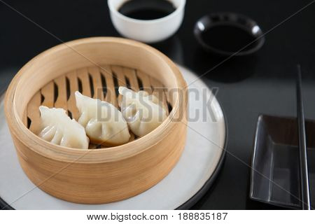 Close-up of steamed dumplings in bamboo steamer