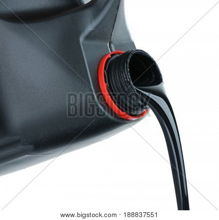 Oil pouring out of black plastic jerrycan on white background