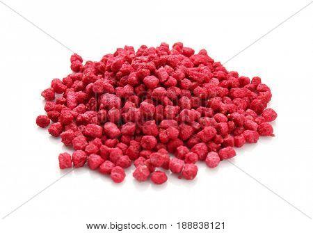 Pile of rat poison on white background