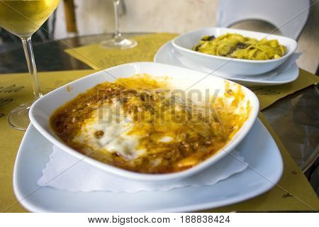 Lasagna and a glass of white wine