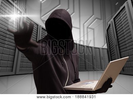 Digital composite of Anonymous Criminal in hood with laptop in front of servers
