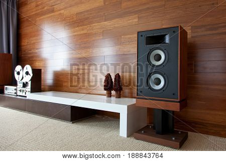 Vintage audio system in minimalistic modern interior, diagonal perspective view