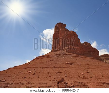 Monument Valley in the United States.  A grandiose rock from red sandstone and the bright midday sun