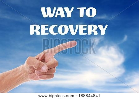 Rehabilitation concept. Senior man pointing WAY TO RECOVERY on sky background