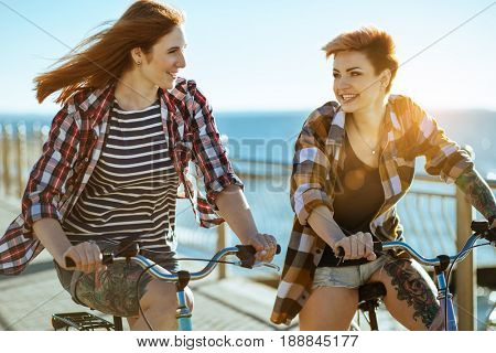 Two women with bicycels