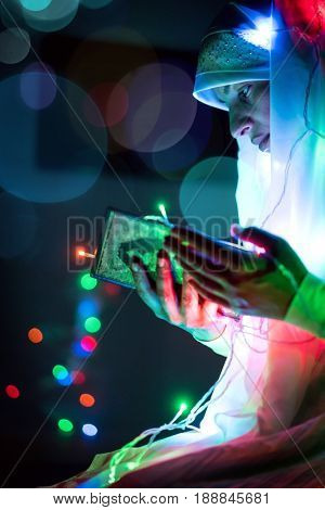 Muslim woman praying in dark room with nice lights around her