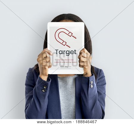 Woman holding digital device covering face network graphic overlay
