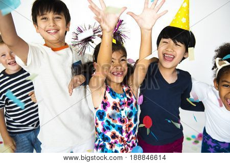 Children standing and celebrating an event