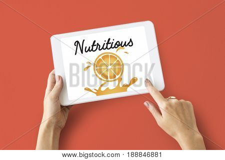 Illustration of nutritious juicy orange on digital tablet