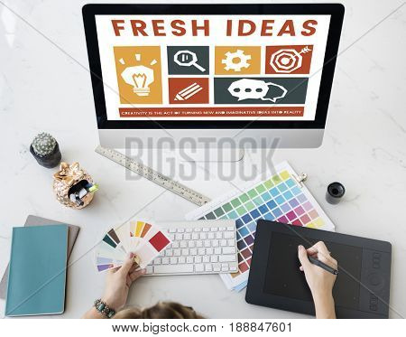 Person working on different icons on the computer