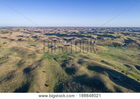 aerial view of Nebraska Sand Hills near Thedford, spring scenery with morning light