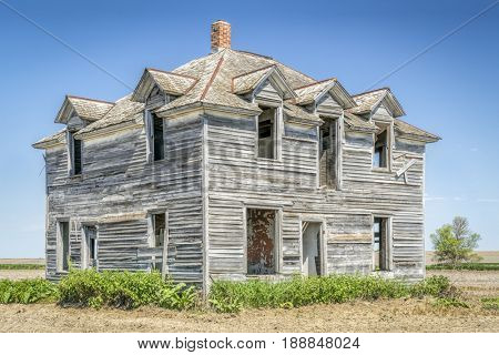 abandoned old house in rural Nebraska in the middle of a field