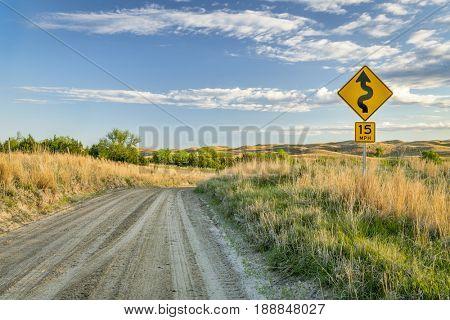 sandy ranch road descending into a valley of DIsmal RIver in Nebraska Sand Hills near Seneca, spring scenery