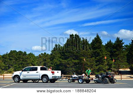 COOS BAY, OREGON, USA - September 3, 2009: Men prepare their four-wheel ATV for riding at the Oregon Dunes National Recreation Area