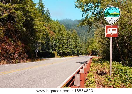 SOUTHWESTERN OREGON, USA - September 2, 2009: Oregon State Parks sign with a camping sign along the side of Highway 101
