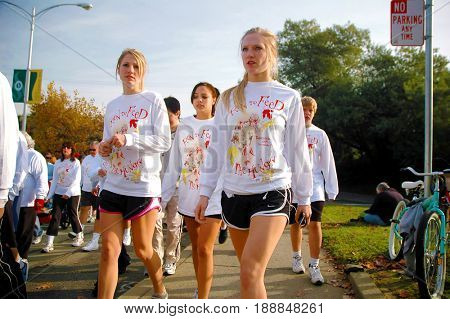 SACRAMENTO, CALIFORNIA, USA - November 26, 2009: Twin teenage girls walking in the Run to Feed the Hungry on Thanksgiving morning