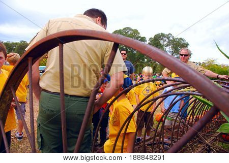 GRANITE BAY, CALIFORNIA, USA - Cub Scouts examine antique farm equipment while on a field trip to a pumpkin farm