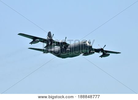 Air Force cargo airplane in flight against blue sky