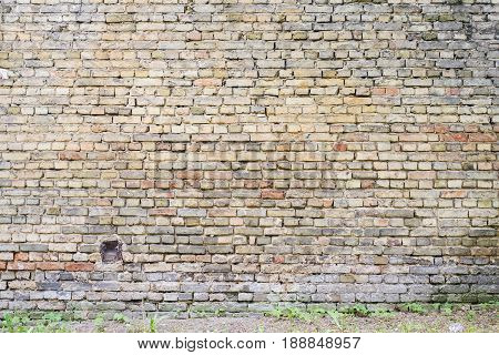 colorful abandoned grunge cracked brick stucco wall background