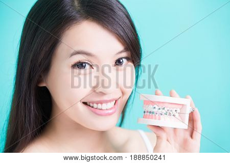 woman with bace tooth model on the green background