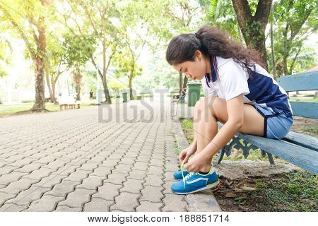 athlete woman sport girl tying laces running shoes for jogging