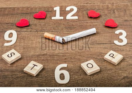STOP word and tobacco on wooden background. World No Tobacco Day.