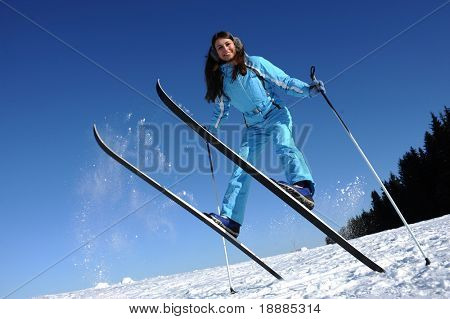 happy young skier in blue sport cloth, good use for winter sports cards and posters