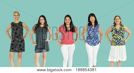 Diverse group of cheerful women standing in a row