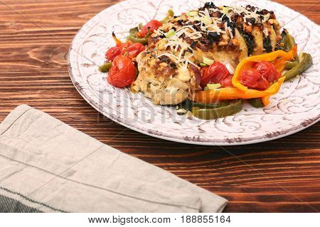 chicken breast stuffed feta cheese and herbs served with vegetables