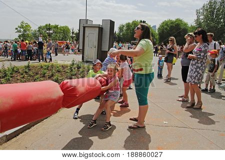 Volgograd Russia - June 01 2014: Children playing Tug Of War on Children Protection Day in Volgograd