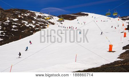 ski track full of snow and ski player with blue sky background