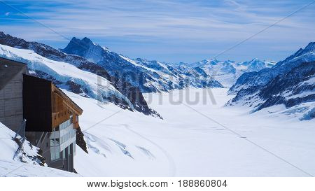 Jungfrau tourist attraction point with snow mountain and blue sky background