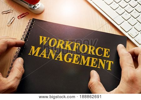 Book with name workforce management in an office.